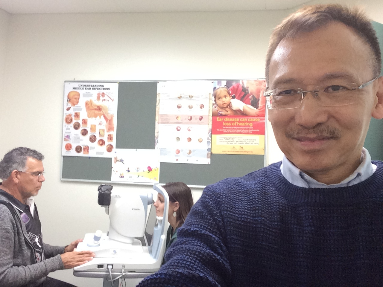 Mastering selfies with a cheeky smile - Vincent Ang (right) in the field.