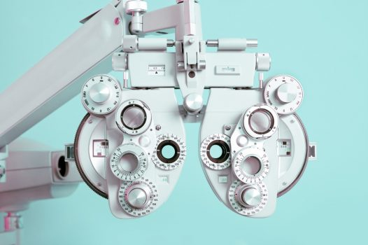Close up of a phoroptor, an instrument used by eye care professionals during an eye examination.